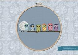 Cute Little Owls on a Branch